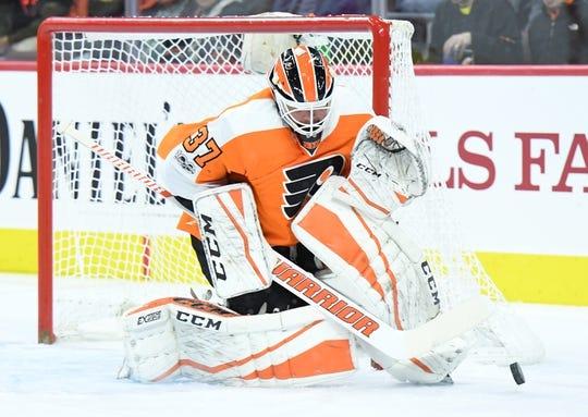 Nov 9, 2017; Philadelphia, PA, USA; Philadelphia Flyers goalie Brian Elliott (37) makes a save against the Chicago Blackhawks during the first period at Wells Fargo Center. Mandatory Credit: Eric Hartline-USA TODAY Sports
