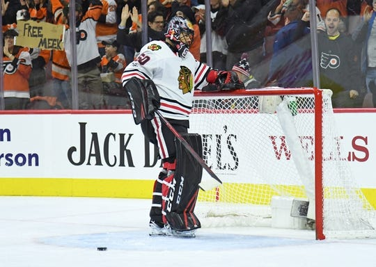 Nov 9, 2017; Philadelphia, PA, USA; Chicago Blackhawks goalie Corey Crawford (50) flips the puck out of the net after goal by Philadelphia Flyers center Sean Couturier (14) (not pictured) during the second period at Wells Fargo Center. Mandatory Credit: Eric Hartline-USA TODAY Sports