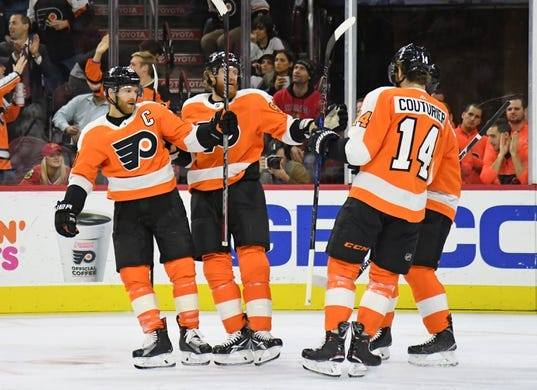 Nov 9, 2017; Philadelphia, PA, USA; Philadelphia Flyers center Sean Couturier (14) celebrates his goal with center Claude Giroux (28) and right wing Jakub Voracek (93) celebrate goal against the Chicago Blackhawks during the second period at Wells Fargo Center. Mandatory Credit: Eric Hartline-USA TODAY Sports