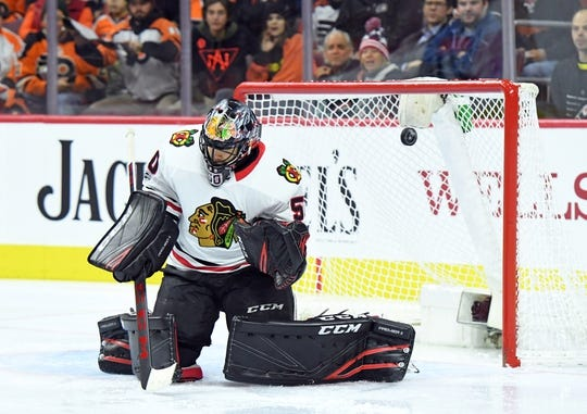 Nov 9, 2017; Philadelphia, PA, USA; Chicago Blackhawks goalie Corey Crawford (50) makes a save against the Philadelphia Flyers during the second period at Wells Fargo Center. Mandatory Credit: Eric Hartline-USA TODAY Sports