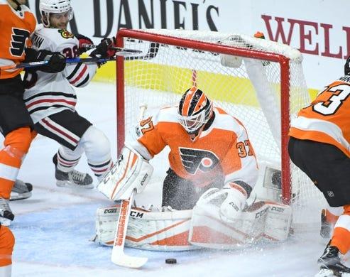 Nov 9, 2017; Philadelphia, PA, USA; Philadelphia Flyers goalie Brian Elliott (37) covers the puck against the Chicago Blackhawks during the third period at Wells Fargo Center. Mandatory Credit: Eric Hartline-USA TODAY Sports