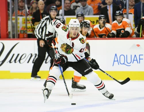 Nov 9, 2017; Philadelphia, PA, USA; Chicago Blackhawks center Jonathan Toews (19) carries the puck into zone against the Philadelphia Flyers during the first period at Wells Fargo Center. Mandatory Credit: Eric Hartline-USA TODAY Sports