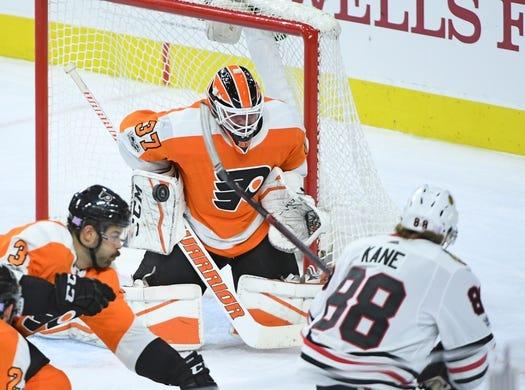 Nov 9, 2017; Philadelphia, PA, USA; Philadelphia Flyers goalie Brian Elliott (37) makes a save against Chicago Blackhawks right wing Patrick Kane (88) during the third period at Wells Fargo Center. Mandatory Credit: Eric Hartline-USA TODAY Sports