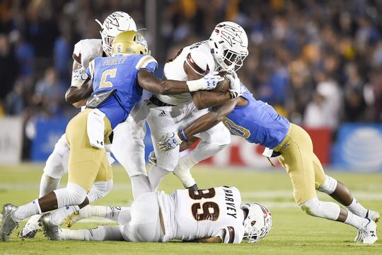 Nov 11, 2017; Pasadena, CA, USA; Arizona State Sun Devils wide receiver Kyle Williams (10) runs the ball defended by UCLA Bruins defensive back Adarius Pickett (6) and defensive back Colin Samuel (right) during the first half at Rose Bowl. Mandatory Credit: Kelvin Kuo-USA TODAY Sports