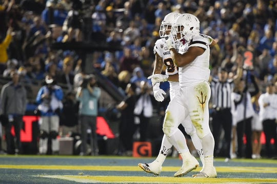Nov 11, 2017; Pasadena, CA, USA; Arizona State Sun Devils running back Demario Richard (4) celebrates after a touchdown run against the UCLA Bruins during the first half at Rose Bowl. Mandatory Credit: Kelvin Kuo-USA TODAY Sports