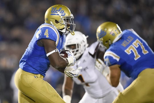 Nov 11, 2017; Pasadena, CA, USA; UCLA Bruins running back Bolu Olorunfunmi (4) runs the ball against the Arizona State Sun Devils during the first half at Rose Bowl. Mandatory Credit: Kelvin Kuo-USA TODAY Sports
