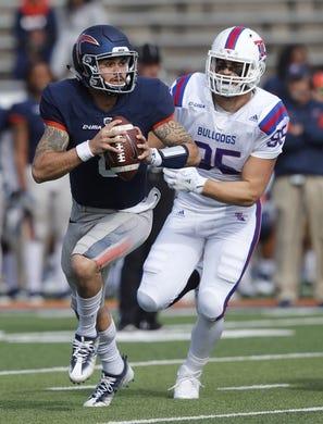 Nov 18, 2017; El Paso, TX, USA; UTEP Miners quarterback Zack Greenlee (8) scrambles against the the Louisiana Tech Bulldogs defense at Sun Bowl. Mandatory Credit: Ivan Pierre Aguirre-USA TODAY Sports