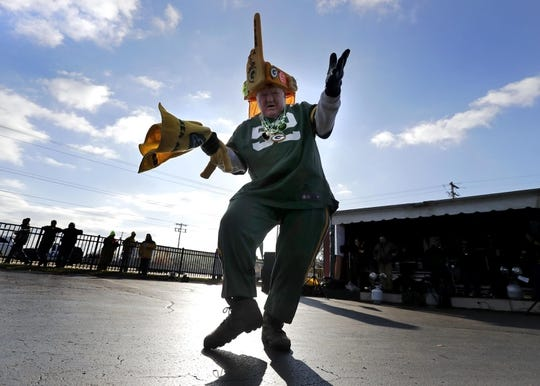 "Nov 19, 2017; Green Bay, WI, USA;  Packers super fan ""Mean\"" Gene Greening revs up tailgaters at Kroll's West before the Green Bay Packers host the Baltimore Ravens in a NFL game at Lambeau Field. Mandatory Credit: William Glasheen/Appleton Post-Crescent via USA TODAY Sports"