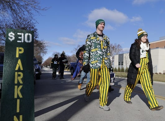 Nov 19, 2017; Green Bay, WI, USA;  Fans walk to the stadium before the Green Bay Packers host the Baltimore Ravens during a NFL game at Lambeau Field. Mandatory Credit: William Glasheen/Appleton Post-Crescent via USA TODAY Sports