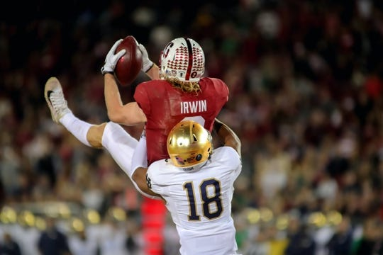 Nov 25, 2017; Stanford, CA, USA; Stanford Cardinal wide receiver Trenton Irwin (2) catches a touchdown pass over Notre Dame Fighting Irish cornerback Troy Pride Jr. (18) during the first quarter at Stanford Stadium. Mandatory Credit: Sergio Estrada-USA TODAY Sports
