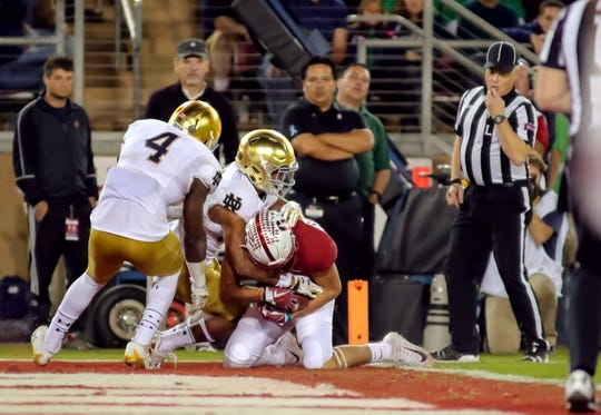Nov 25, 2017; Stanford, CA, USA; Stanford Cardinal wide receiver JJ Arcega-Whiteside (19) catches a touchdown pass against the Notre Dame Fighting Irish during the second quarter at Stanford Stadium. Mandatory Credit: Sergio Estrada-USA TODAY Sports