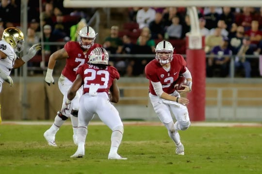 Nov 25, 2017; Stanford, CA, USA; Stanford Cardinal quarterback K.J. Costello (3) scrambles with the football against the Notre Dame Fighting Irish during the second quarter at Stanford Stadium. Mandatory Credit: Sergio Estrada-USA TODAY Sports