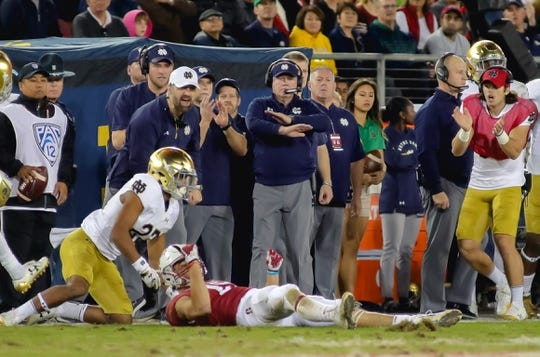 Nov 25, 2017; Stanford, CA, USA; Notre Dame Fighting Irish head coach Brian Kelly reacts after a play against the Stanford Cardinal during the second quarter at Stanford Stadium. Mandatory Credit: Sergio Estrada-USA TODAY Sports