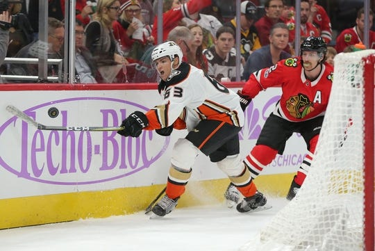 Nov 27, 2017; Chicago, IL, USA; Anaheim Ducks left wing Kevin Roy (63) and Chicago Blackhawks defenseman Duncan Keith (2) fight for the puck during the second period at the United Center. Mandatory Credit: Dennis Wierzbicki-USA TODAY Sports