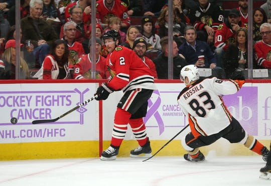 Nov 27, 2017; Chicago, IL, USA; Chicago Blackhawks defenseman Duncan Keith (2) clears the puck in front of Anaheim Ducks center Kalle Kossila (83) during the second period at the United Center. Mandatory Credit: Dennis Wierzbicki-USA TODAY Sports