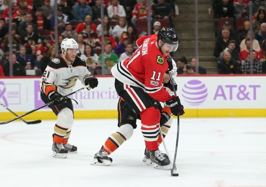Nov 27, 2017; Chicago, IL, USA; Chicago Blackhawks defenseman Cody Franson (11) clears the puck from Anaheim Ducks left wing Andrew Cogliano (7) during the second period at the United Center. Mandatory Credit: Dennis Wierzbicki-USA TODAY Sports