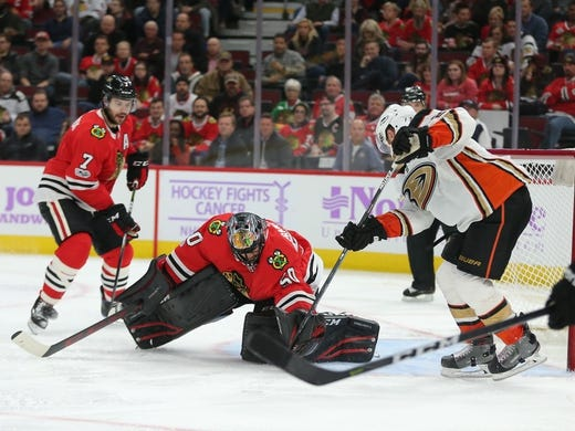 Nov 27, 2017; Chicago, IL, USA; Anaheim Ducks center Chris Wagner (21) scores a goal past Chicago Blackhawks goalie Corey Crawford (50) during the third period at the United Center. Chicago won 7-3. Mandatory Credit: Dennis Wierzbicki-USA TODAY Sports