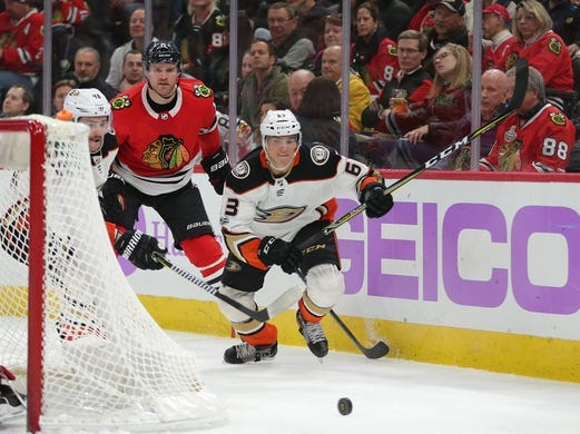 Nov 27, 2017; Chicago, IL, USA; Anaheim Ducks left wing Kevin Roy (63) and Chicago Blackhawks defenseman Cody Franson (11) chase the puck during the third period at the United Center. Chicago won 7-3. Mandatory Credit: Dennis Wierzbicki-USA TODAY Sports