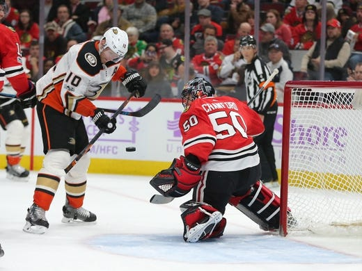 Nov 27, 2017; Chicago, IL, USA; Anaheim Ducks right wing Corey Perry (10) takes a shot on Chicago Blackhawks goalie Corey Crawford (50) during the third period at the United Center. Chicago won 7-3. Mandatory Credit: Dennis Wierzbicki-USA TODAY Sports