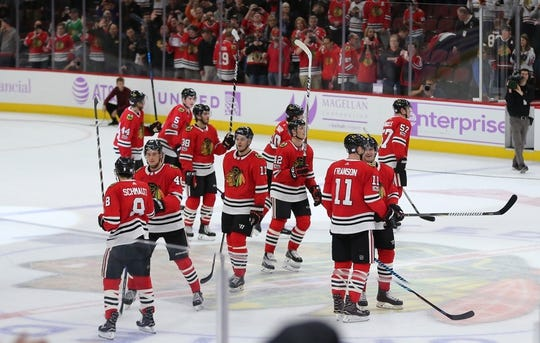 Nov 27, 2017; Chicago, IL, USA; The Chicago Blackhawks celebrate their victory following the third period against the Anaheim Ducks at the United Center. Chicago won 7-3. Mandatory Credit: Dennis Wierzbicki-USA TODAY Sports