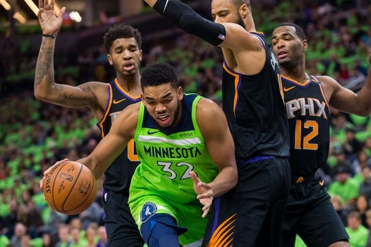 Dec 16, 2017; Minneapolis, MN, USA; Minnesota Timberwolves center Karl-Anthony Towns (32) drives in the first quarter against the Phoenix Suns center Tyson Chandler (4) at Target Center. Mandatory Credit: Brad Rempel-USA TODAY Sports