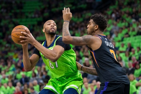 Dec 16, 2017; Minneapolis, MN, USA; Minnesota Timberwolves forward Taj Gibson (67) shoots in the first quarter against the Phoenix Suns forward Marquese Chriss (0) at Target Center. Mandatory Credit: Brad Rempel-USA TODAY Sports