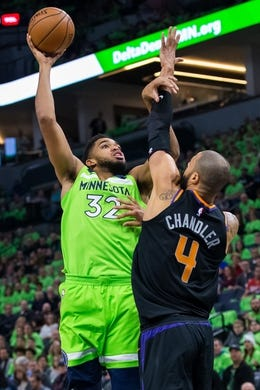 Dec 16, 2017; Minneapolis, MN, USA; Minnesota Timberwolves center Karl-Anthony Towns (32) shoots in the first quarter against the Phoenix Suns center Tyson Chandler (4) at Target Center. Mandatory Credit: Brad Rempel-USA TODAY Sports