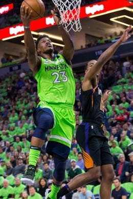 Dec 16, 2017; Minneapolis, MN, USA; Minnesota Timberwolves forward Jimmy Butler (23) shoots in the first quarter against the Phoenix Suns at Target Center. Mandatory Credit: Brad Rempel-USA TODAY Sports
