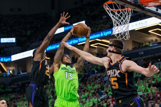 Dec 16, 2017; Minneapolis, MN, USA; Minnesota Timberwolves guard Marcus Georges-Hunt (13) dunks in the second quarter against the Phoenix Suns at Target Center. Mandatory Credit: Brad Rempel-USA TODAY Sports