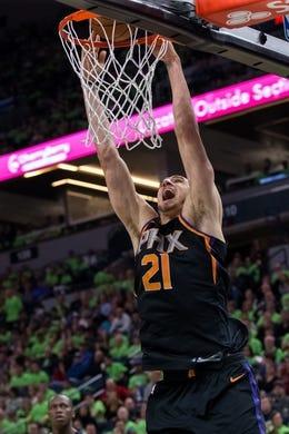 Dec 16, 2017; Minneapolis, MN, USA; Phoenix Suns center Alex Len (21) dunks in the third quarter against the Minnesota Timberwolves at Target Center. Mandatory Credit: Brad Rempel-USA TODAY Sports