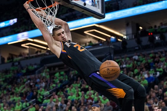 Dec 16, 2017; Minneapolis, MN, USA; Phoenix Suns center Alex Len (21) dunks in the fourth quarter against the Minnesota Timberwolves at Target Center. Mandatory Credit: Brad Rempel-USA TODAY Sports