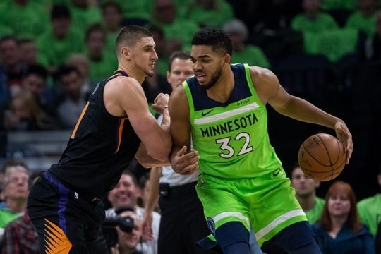 Dec 16, 2017; Minneapolis, MN, USA; Phoenix Suns center Alex Len (21) defends Minnesota Timberwolves center Karl-Anthony Towns (32)in the fourth quarter at Target Center. Mandatory Credit: Brad Rempel-USA TODAY Sports