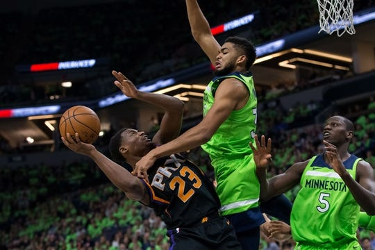 Dec 16, 2017; Minneapolis, MN, USA; Minnesota Timberwolves center Karl-Anthony Towns (32) fouls Phoenix Suns forward Danuel House (23) in the fourth quarter at Target Center. Mandatory Credit: Brad Rempel-USA TODAY Sports