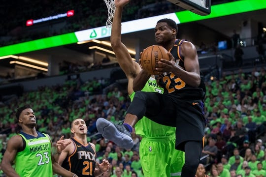 Dec 16, 2017; Minneapolis, MN, USA; Phoenix Suns forward Danuel House (23) passes in the fourth quarter against the Minnesota Timberwolves at Target Center. Mandatory Credit: Brad Rempel-USA TODAY Sports