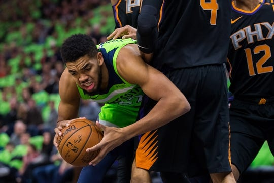 Dec 16, 2017; Minneapolis, MN, USA; Minnesota Timberwolves center Karl-Anthony Towns (32) controls the ball in the first quarter against the Phoenix Suns center Tyson Chandler (4) at Target Center. Mandatory Credit: Brad Rempel-USA TODAY Sports