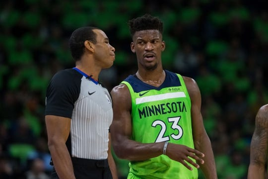 Dec 16, 2017; Minneapolis, MN, USA; Minnesota Timberwolves forward Jimmy Butler (23) talks to referee Phenizee Ransom in the second quarter against the Phoenix Suns at Target Center. Mandatory Credit: Brad Rempel-USA TODAY Sports