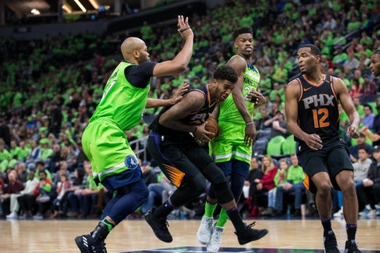 Dec 16, 2017; Minneapolis, MN, USA; Phoenix Suns forward Marquese Chriss (0) drives to the basket in the third quarter against the Minnesota Timberwolves forward Taj Gibson (67) at Target Center. Mandatory Credit: Brad Rempel-USA TODAY Sports