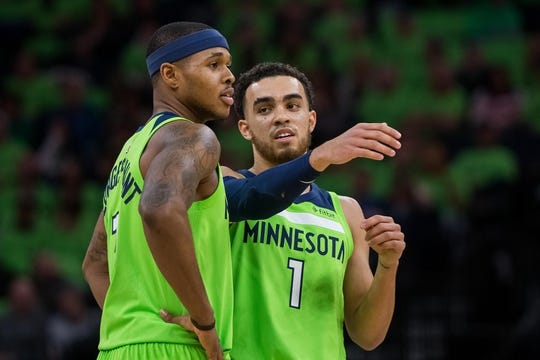 Dec 16, 2017; Minneapolis, MN, USA; Minnesota Timberwolves guard Tyus Jones (1) talks to guard Marcus Georges-Hunt (13) in the second quarter against the Phoenix Suns at Target Center. Mandatory Credit: Brad Rempel-USA TODAY Sports