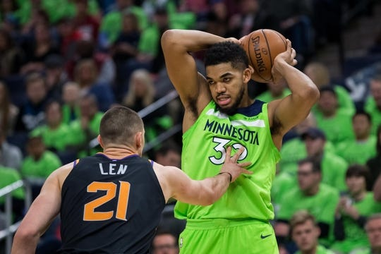 Dec 16, 2017; Minneapolis, MN, USA; Minnesota Timberwolves center Karl-Anthony Towns (32) looks to pass in the second quarter against the Phoenix Suns center Alex Len (21) at Target Center. Mandatory Credit: Brad Rempel-USA TODAY Sports