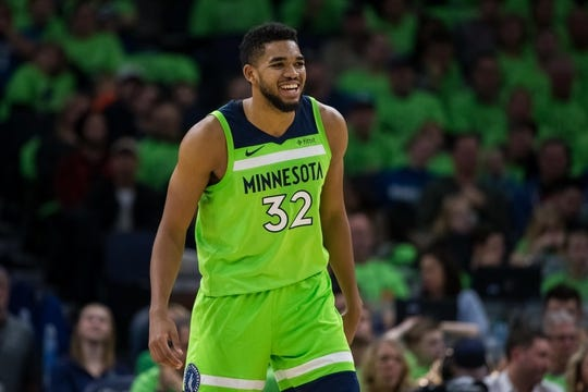 Dec 16, 2017; Minneapolis, MN, USA; Minnesota Timberwolves center Karl-Anthony Towns (32) smiling in the second quarter against the Phoenix Suns at Target Center. Mandatory Credit: Brad Rempel-USA TODAY Sports