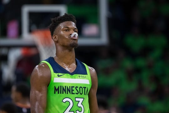 Dec 16, 2017; Minneapolis, MN, USA; Minnesota Timberwolves forward Jimmy Butler (23) reacts to a call in the second quarter against the Phoenix Suns at Target Center. Mandatory Credit: Brad Rempel-USA TODAY Sports