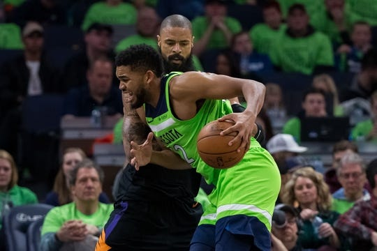 Dec 16, 2017; Minneapolis, MN, USA; Phoenix Suns center Tyson Chandler (4) defends Minnesota Timberwolves center Karl-Anthony Towns (32) in the third quarter at Target Center. Mandatory Credit: Brad Rempel-USA TODAY Sports