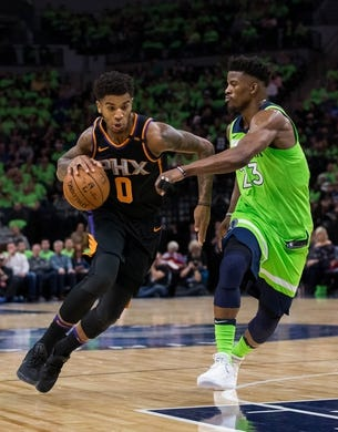 Dec 16, 2017; Minneapolis, MN, USA; Phoenix Suns forward Marquese Chriss (0) dribbles in the third quarter against the Minnesota Timberwolves forward Jimmy Butler (23) at Target Center. Mandatory Credit: Brad Rempel-USA TODAY Sports
