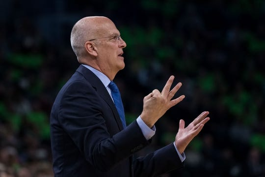 Dec 16, 2017; Minneapolis, MN, USA; Phoenix Suns interim head coach Jay Triano signals the referee in the third quarter against the Minnesota Timberwolves at Target Center. Mandatory Credit: Brad Rempel-USA TODAY Sports