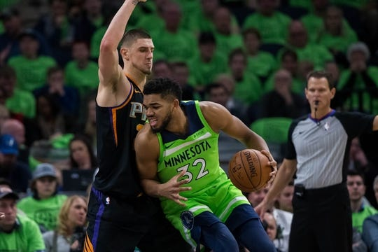 Dec 16, 2017; Minneapolis, MN, USA; Phoenix Suns center Alex Len (21) defends Minnesota Timberwolves center Karl-Anthony Towns (32) in the fourth quarter at Target Center. Mandatory Credit: Brad Rempel-USA TODAY Sports
