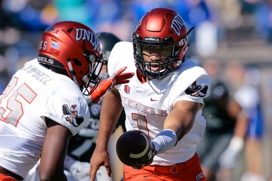 Oct 14, 2017; Colorado Springs, CO, USA; UNLV Rebels quarterback Armani Rogers (1) looks to hand off to running back Xzaviar Campbell (35) in the first quarter against the Air Force Falcons at Falcon Stadium. Mandatory Credit: Isaiah J. Downing-USA TODAY Sports