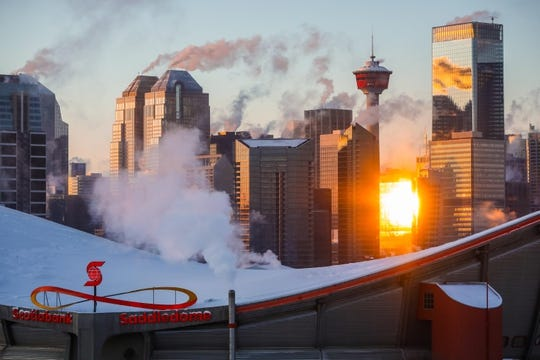 Dec 31, 2017; Calgary, Alberta, CAN; Scotiabank Saddledome and downtown Calgary prior to the game between the Calgary Flames and the Chicago Blackhawks. Mandatory Credit: Sergei Belski-USA TODAY Sports