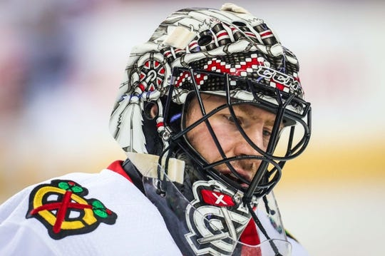 Dec 31, 2017; Calgary, Alberta, CAN; Chicago Blackhawks goaltender Jeff Glass (30) during the warmup period against the Calgary Flames at Scotiabank Saddledome. Mandatory Credit: Sergei Belski-USA TODAY Sports