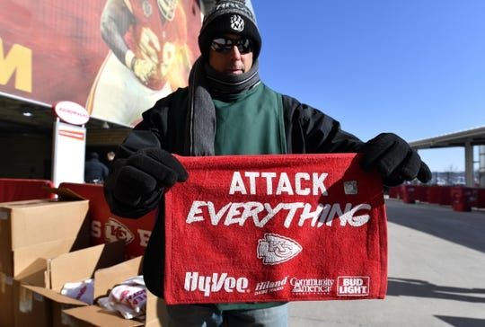 Jan 6, 2018; Kansas City, MO, USA; A worker shows off a rally towel before the AFC Wild Card playoff football game between the Kansas City Chiefs and the Tennessee Titans at Arrowhead Stadium. Mandatory Credit: Denny Medley-USA TODAY Sports