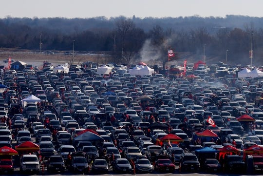Jan 6, 2018; Kansas City, MO, USA; Football fans tailgate in the parking lot before the AFC Wild Card playoff football game between the Kansas City Chiefs and the Tennessee Titans at Arrowhead. Mandatory Credit: Jay Biggerstaff-USA TODAY Sports